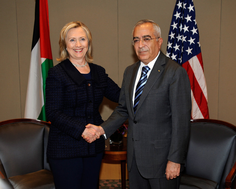 Secretary Clinton Shakes Hands With Palestinian Prime Minister Fayyad