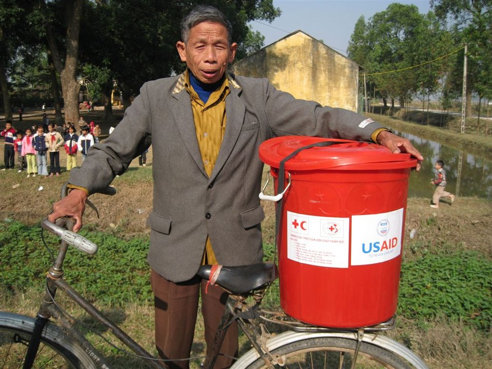 Nguyen Van Luong, of Lien Chau District, receives assistance funded by USAID