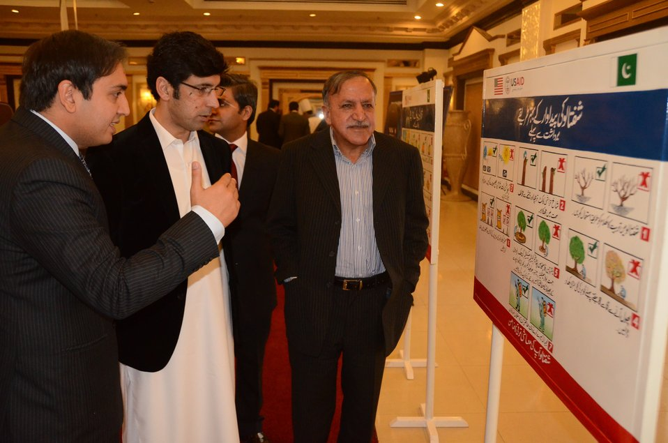 Shahram Khan Tarrakai Minister for Agriculture, Livestock and Cooperation KP with USAID Firms project staff at the project interventions walk-through.