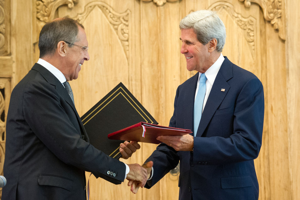 Secretary Kerry and Russian Foreign Minister Lavrov Shake Hands at the Nuclear Risk Reduction Centers Agreement Signing Ceremony
