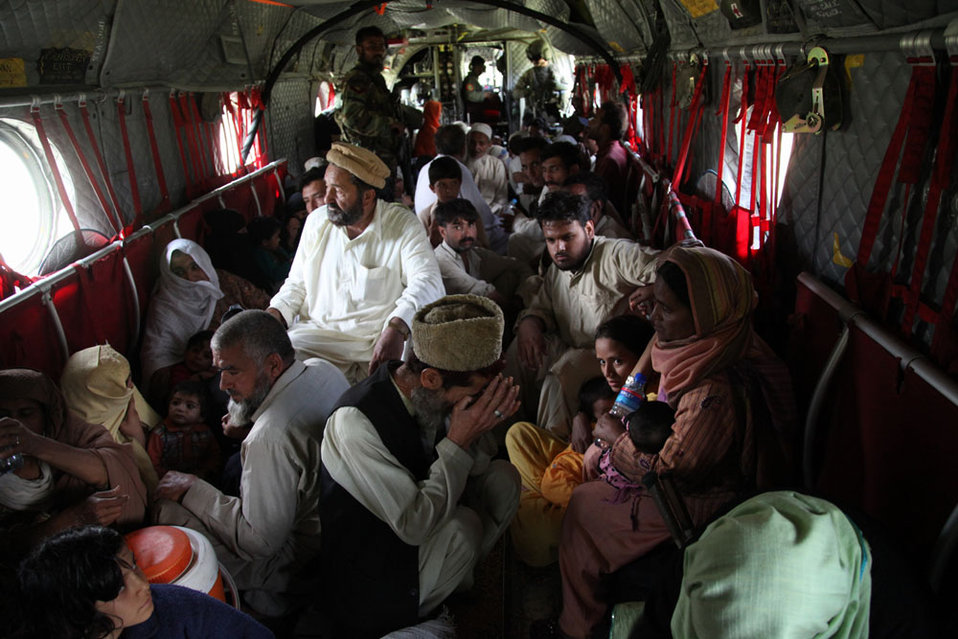 Pakistani Victims of the Flooding Are Seated on the Floor