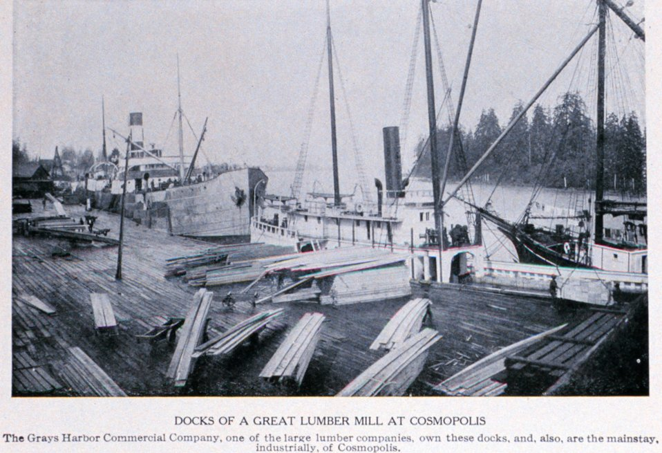 'The Docks of a Great Lumber Mill at Cosmopolis', Grays Harbor. In:  'Puget Sound and Western Washington  Cities-Towns Scenery', by Robert A. Reid, Robert A. Reid Publisher, Seattle, 1912.  P. 156.