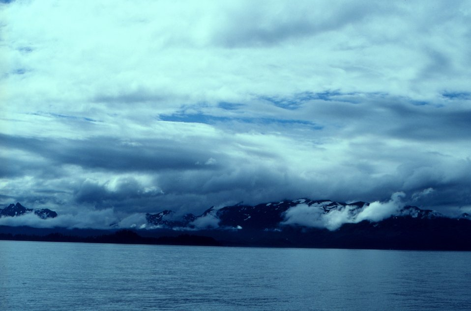 Clouds and mountains meet the sea on the Alaska Peninsula.