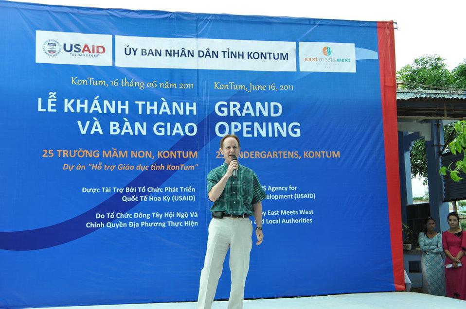 USAID Director Francis Donovan performs at the kindergarten handover program
