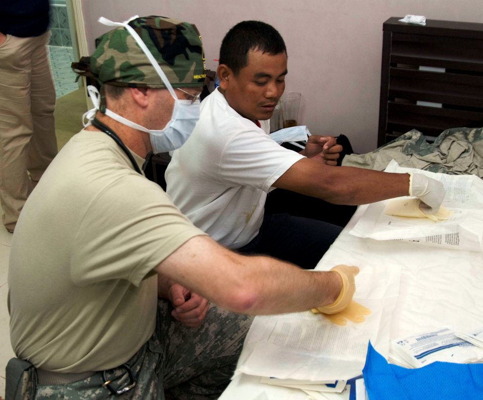 Veterinarian Army Capt. (Dr.) Eric Storey Shows a Technique to Cambodian Veterinarian Pao Thunn