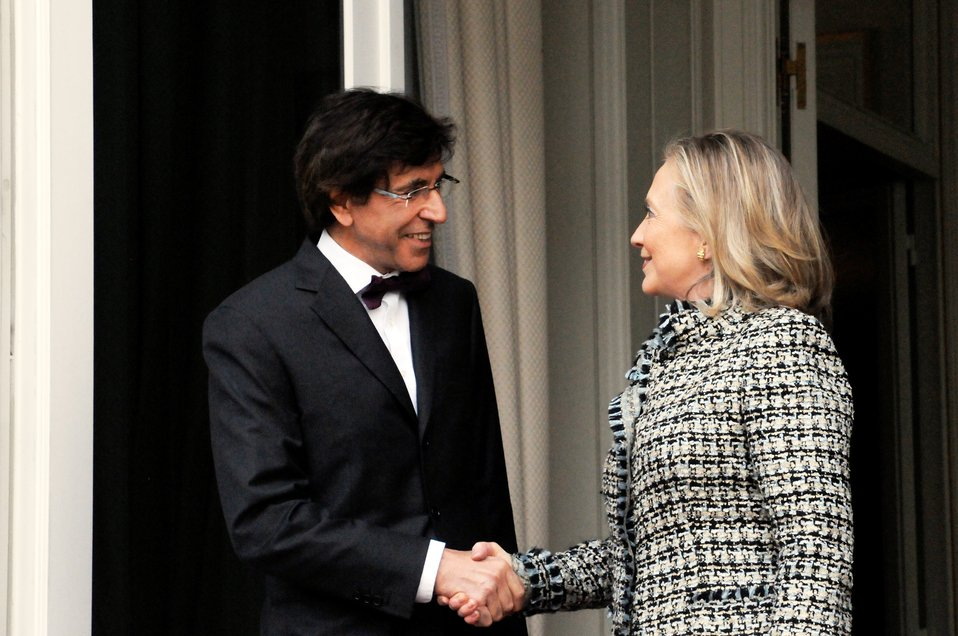Secretary Clinton Is Greeted By Belgian Prime Minister Di Rupo