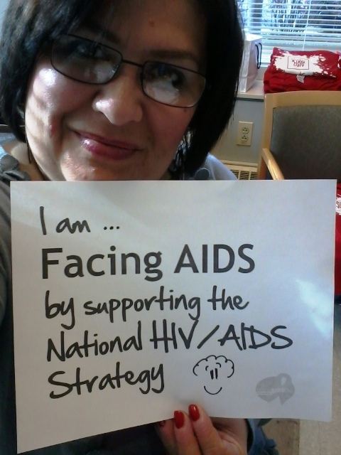 Woman Facing AIDS through supporting NHAS-47