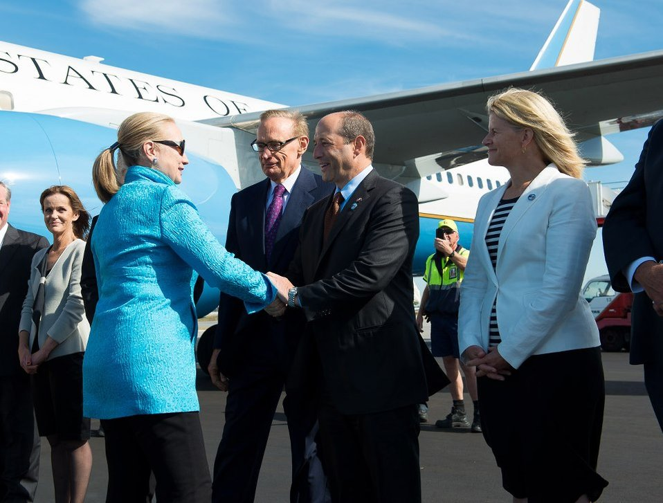 Secretary Clinton Is Greeted By Ambassador Bleich