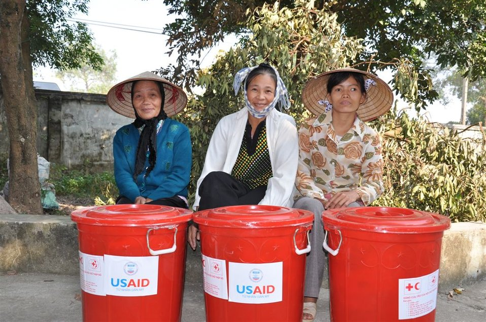 Residents near Hanoi receive disaster assistance from USAID and the Red Cross.