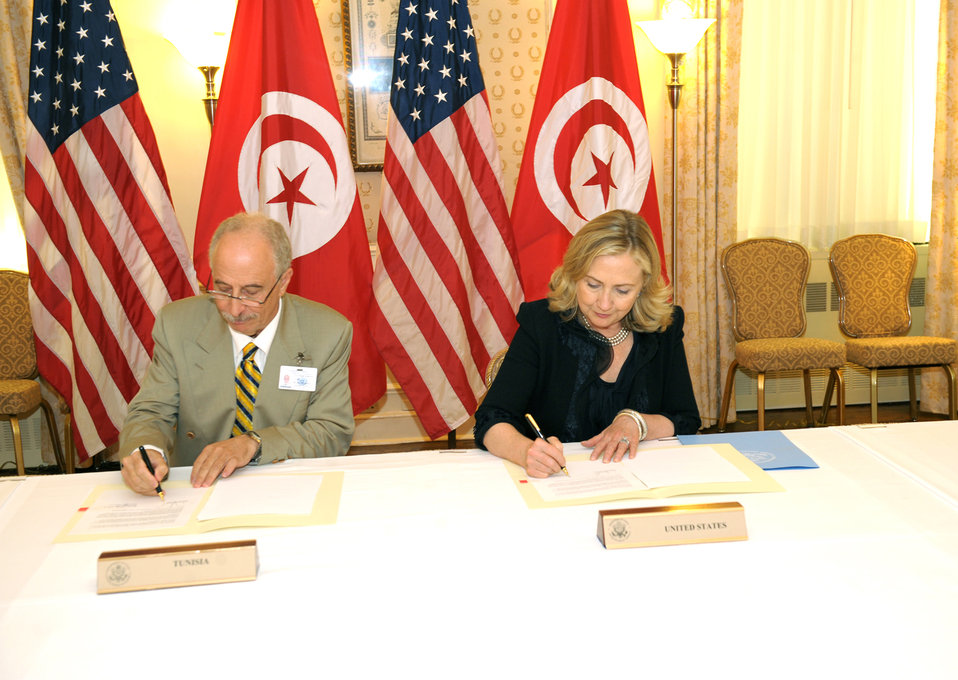 Secretary Clinton and Tunisian Foreign Minister Kefi Participate in a Signing Ceremony