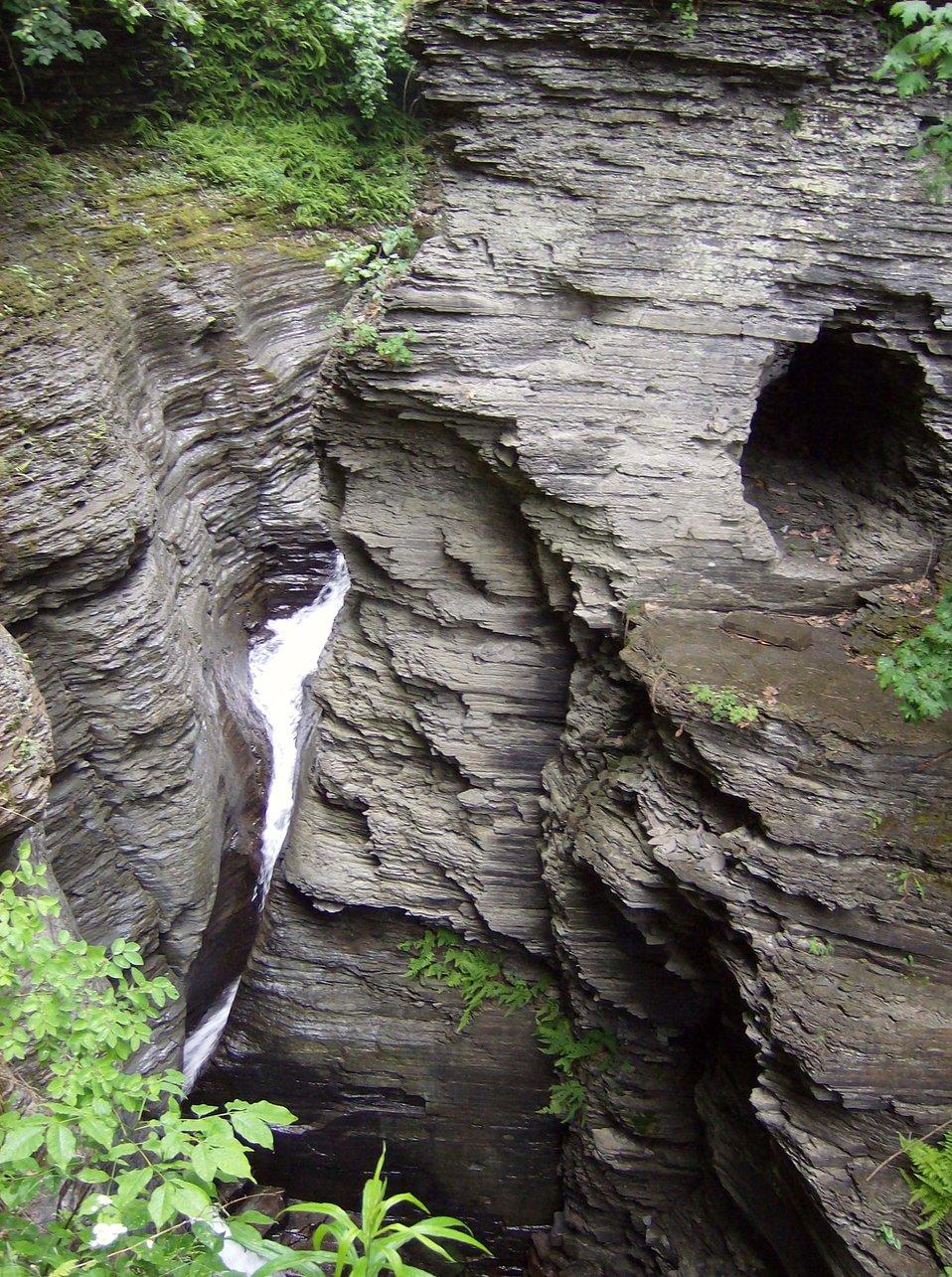 Stream following a steep and narrow canyon at Watkins Glen State Park.