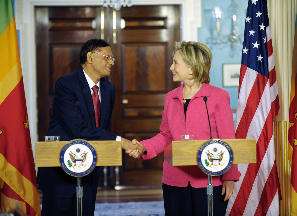Secretary Clinton Shakes Hands With Sri Lanka Minister of External Affairs G.L. Peiris