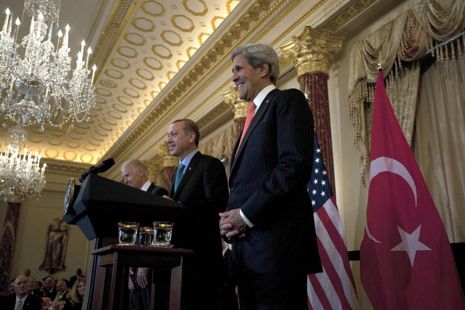 Secretary Kerry Listens as Turkish Prime Minister Erdogan Delivers Remarks