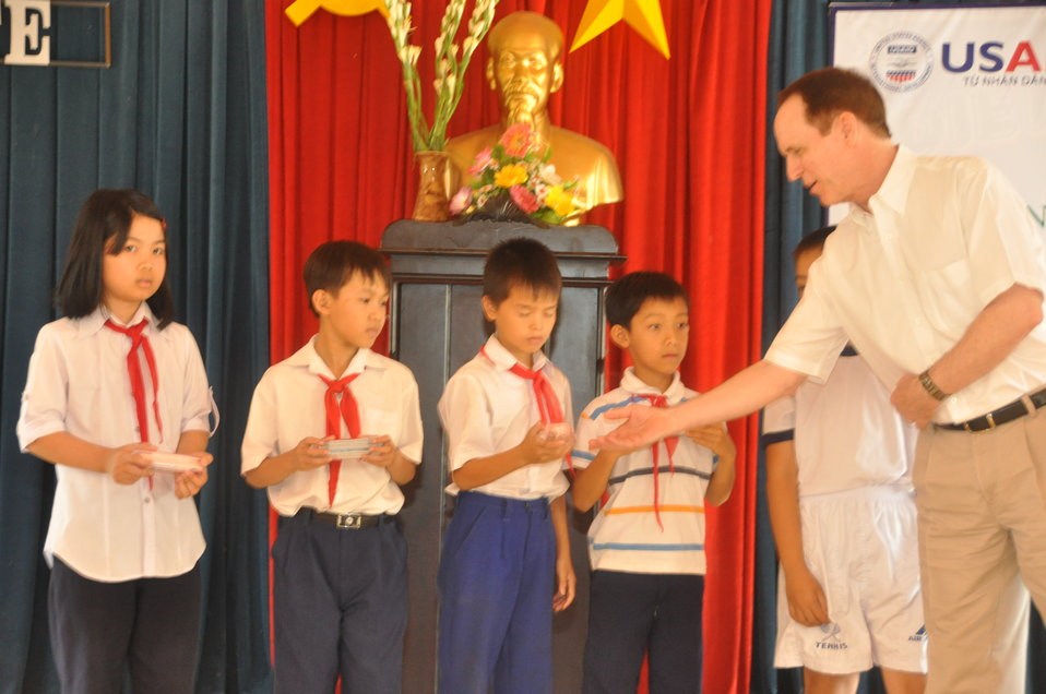 USAID Director Francis Donovan: chool children in Dak To, Kon Tum Province, receive eyeglasses under a program supported by USAID and partners HKI and World Leraning