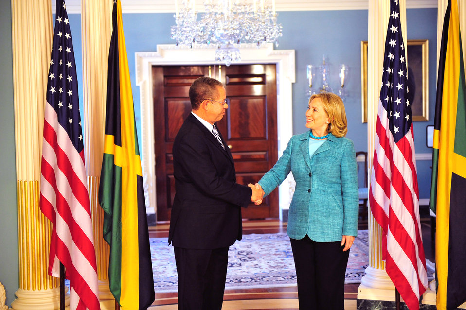 Secretary Clinton Shakes Hands With Jamaican Prime Minister Golding