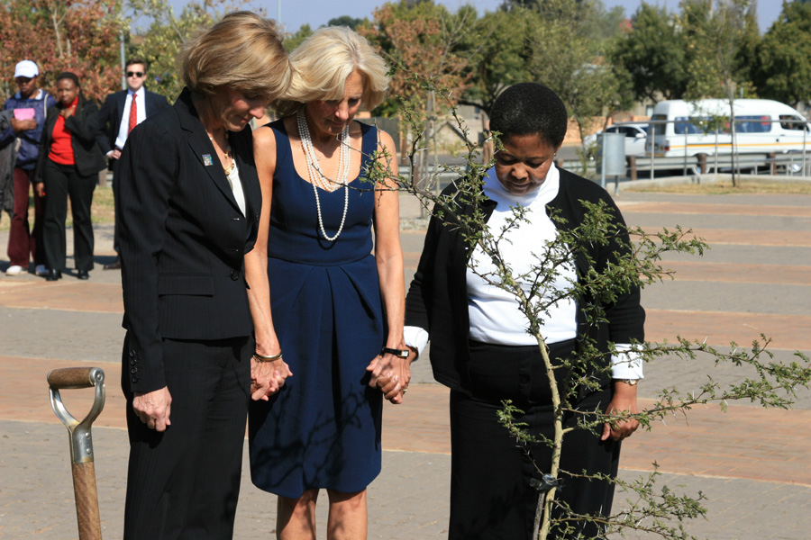 Dr. Jill Biden and Liz Berry Gips Plant Tree to Honor Youth Killed in 1976