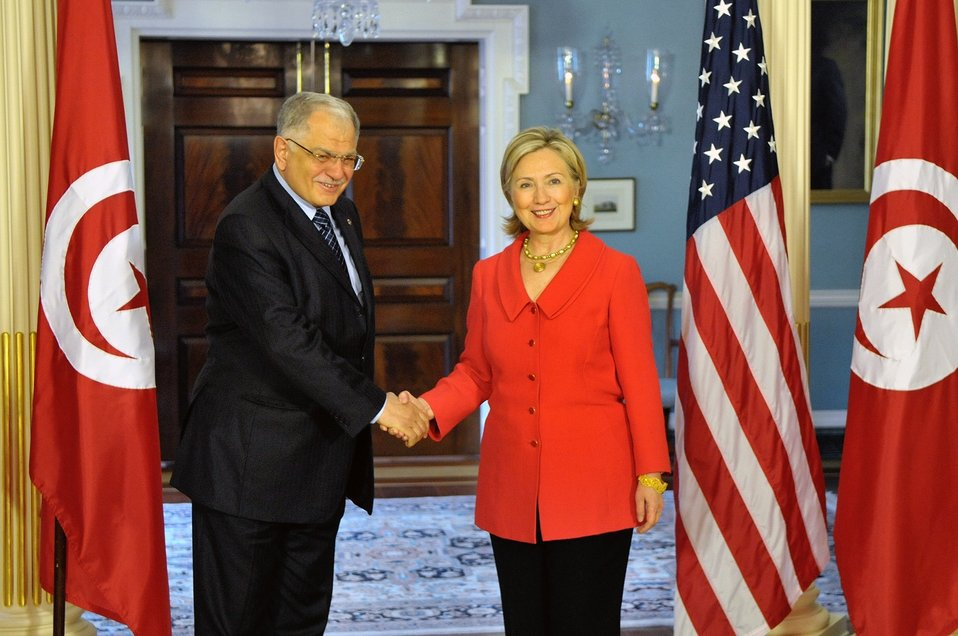Secretary Clinton Shakes Hands With Tunisian Foreign Minister Morjane