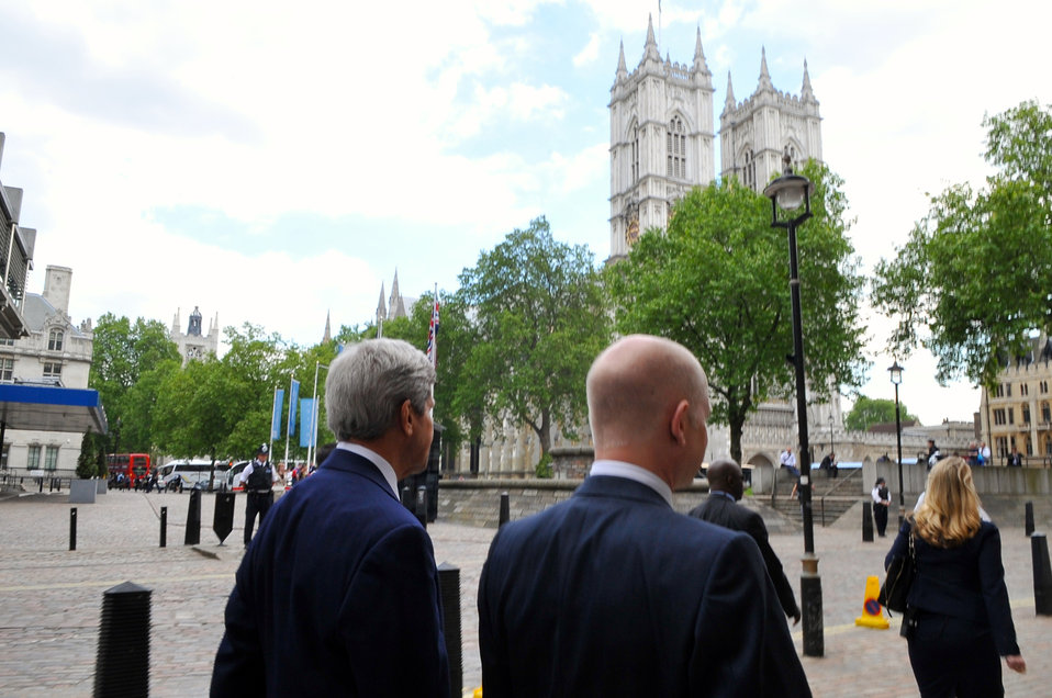 Secretaries Kerry, Hague Pass Westminster Abbey During Walk in London