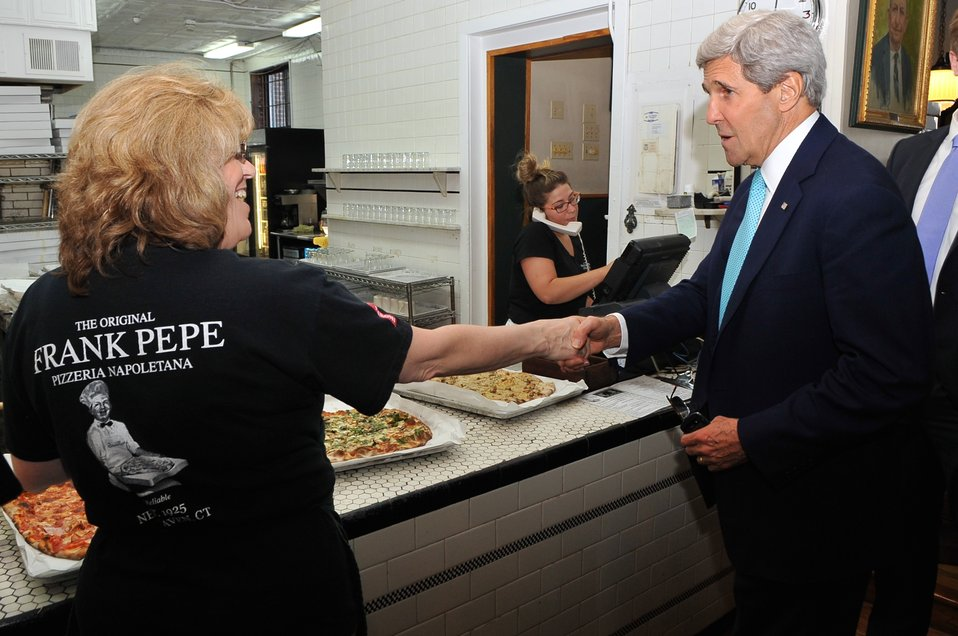 Secretary Kerry Speaks With Server at New Haven Pizza Shop