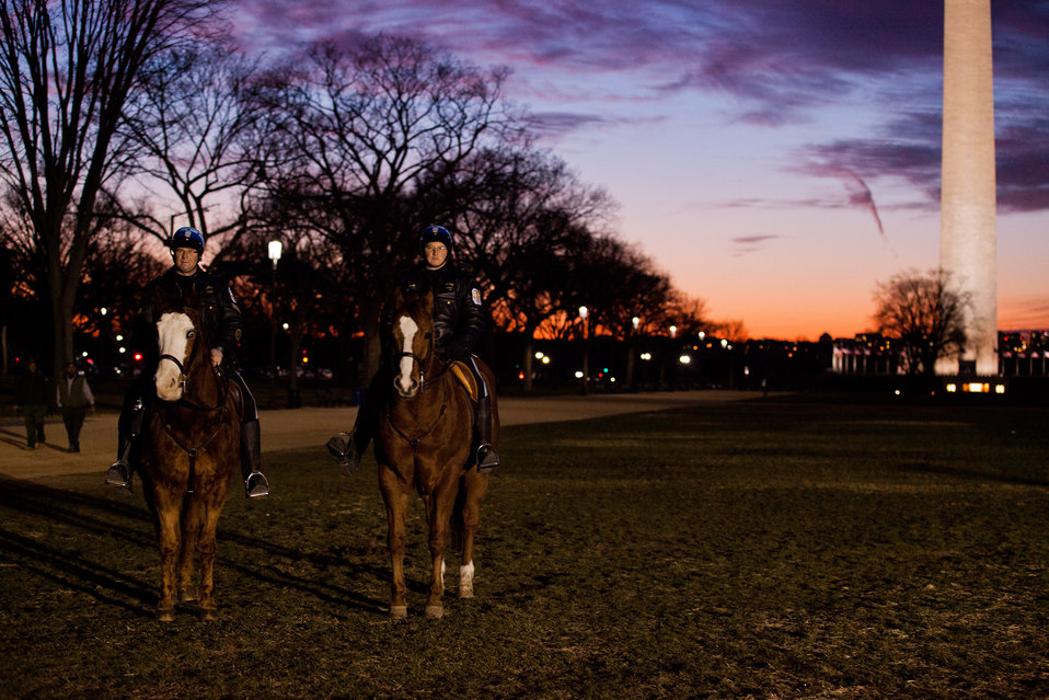 Two National Park Policeman on horseback with the new LED technology lighting the path to the Washington Monument in the background.