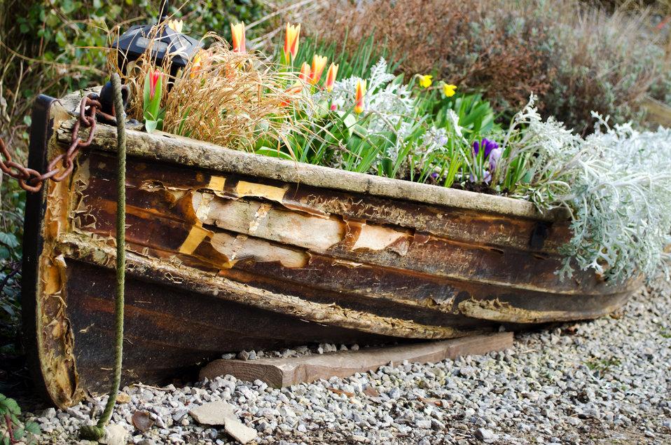 Old ship full of flowers