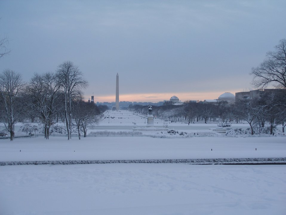 Looking west over the National Mall to the Washington Monument.  General Grant on his horse is perpetually surveying the view while the round domes to the right are Smithsonian museums.  The top of the Smithsonian Castle is seen to  the left.