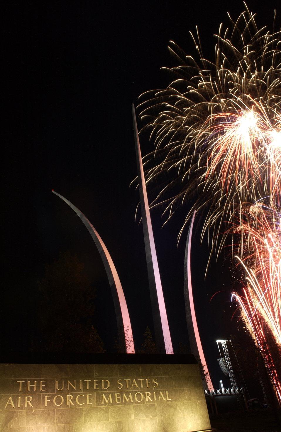 Fireworks light the night sky at memorial dedication event