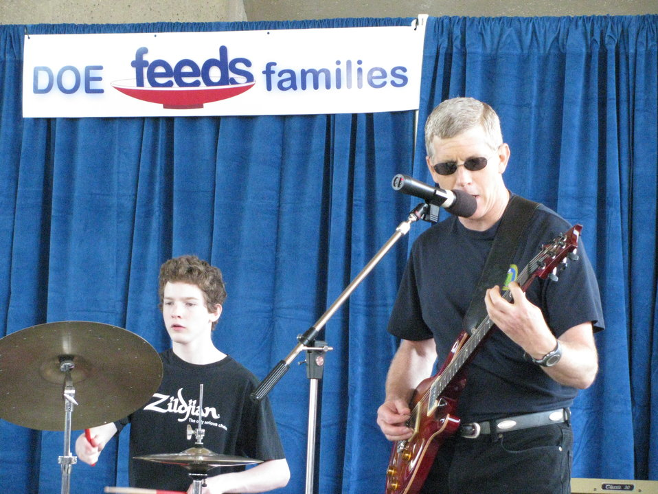 Deputy Secretary Daniel Poneman, and son, in the band 'Yellow Cake'