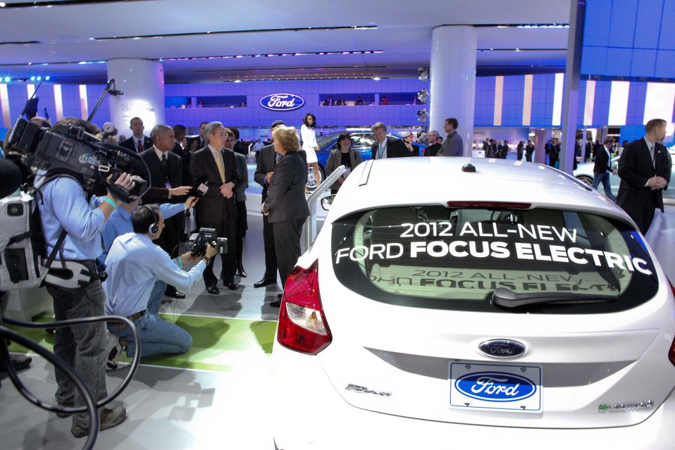 Sue Cischke (Ford Group Vice President) is telling Secretary Chu about the 2012 Ford Focus electric. 