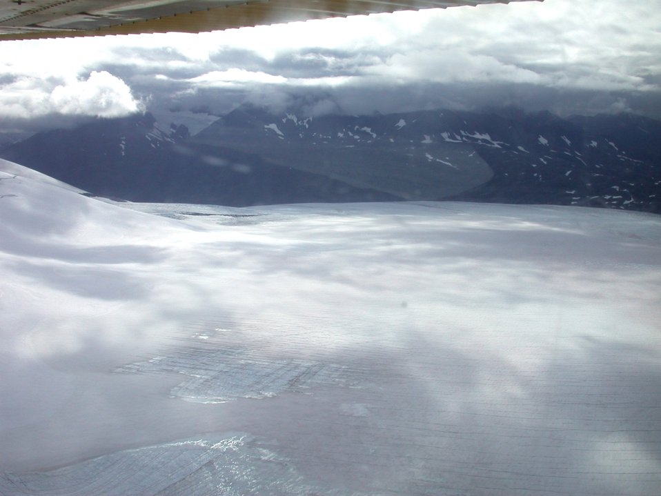 Float plane sightseeing along the Richardson Highway. Note cracks in glacier.