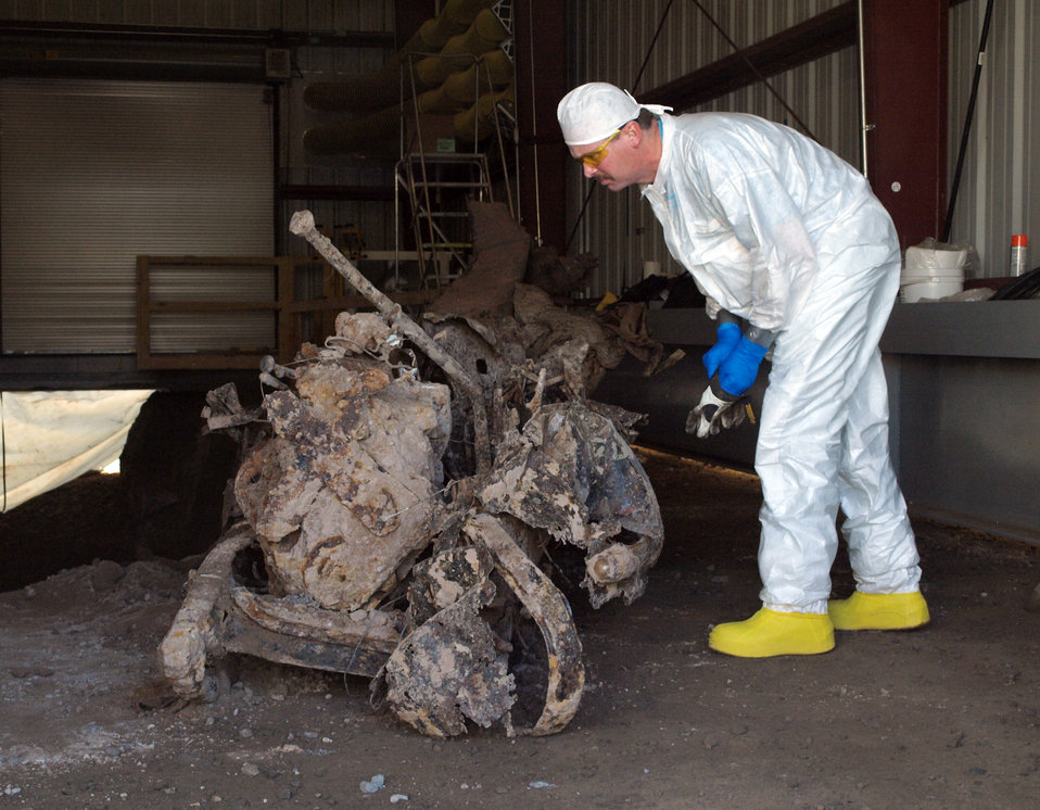 Remnants of 1940s military truck buried in a Manhattan Project-era landfill