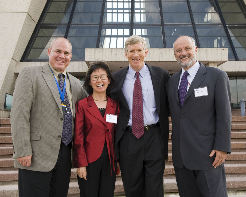 Group photo in front of Wilson Hall, Fermilab's 16-story landmark building: Mark Bollinger, DOE Fermi Site Office (left); Young-Kee Kim, Fermilab deputy director; DOE Deputy Secretary Daniel Poneman; Pier Oddone, Fermilab director.