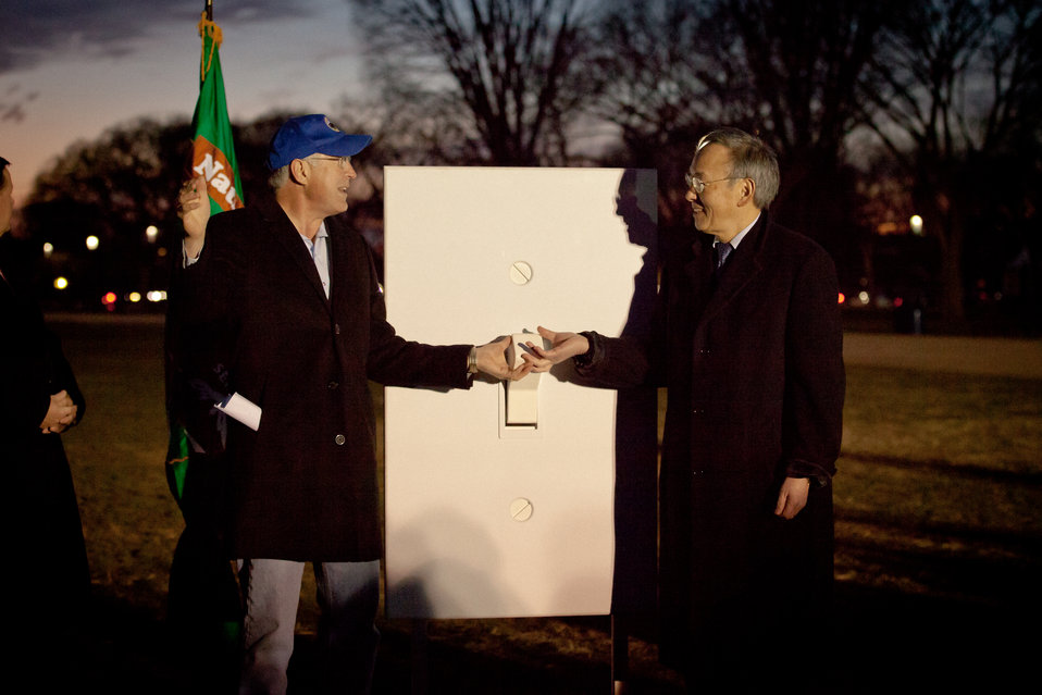 Interior Secretary Ken Salazar (Left) and Energy Secretary Steven Chu (Right) flip the switch to shine LED lighting on the elm paths of the