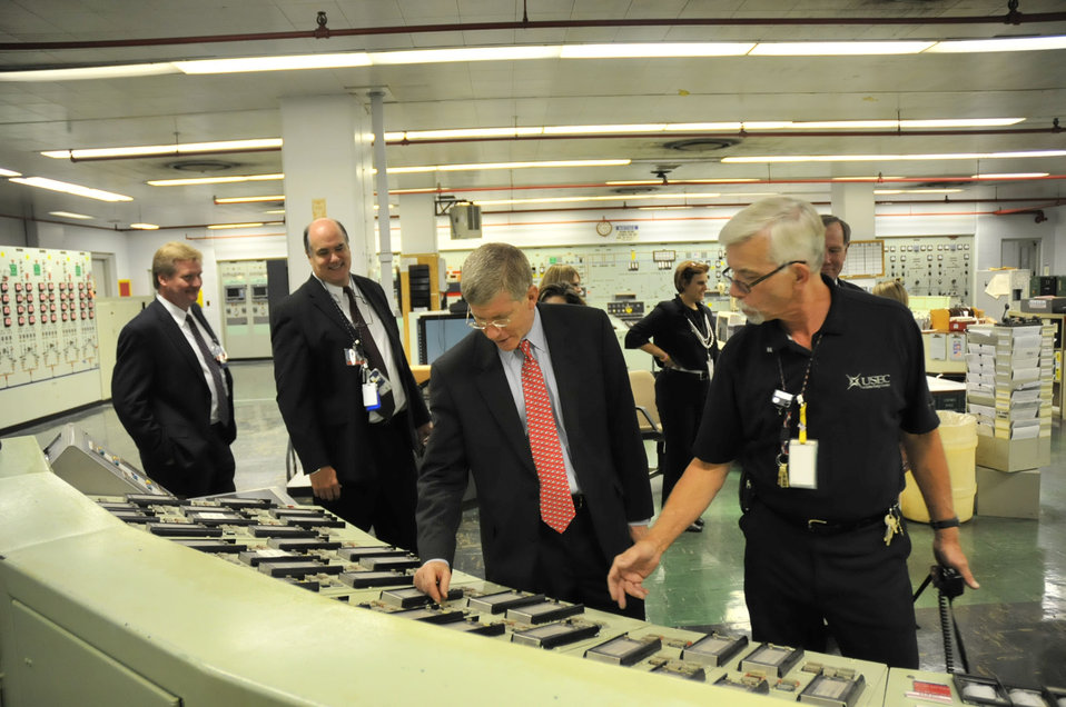 Deputy Secretary Daniel Poneman observes instrumentation in the X-333 Process Building Control Room during his visit to the Portsmouth Gaseous Diffusion Plant.