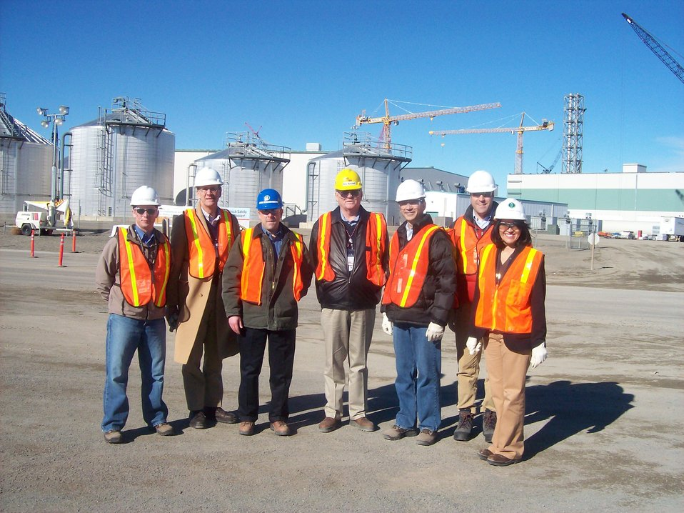 Albright group photo with tanks and cranes