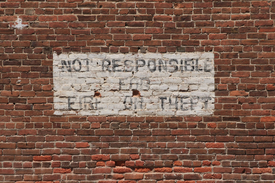 Brick wall with painted sign