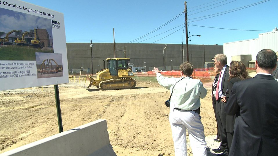 LATA/Parallax Portsmouth Project Manager Linda Bauer points out to Deputy Secretary Poneman the site where the X-760 Chemical Engineering Building once stood at the Portsmouth Site.