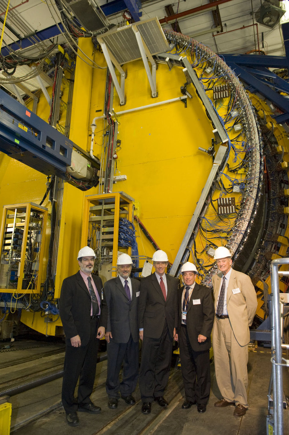 During his tour of the laboratory, Deputy Secretary Poneman (center) visited the 45-foot-high Collider Detector at Fermilab (CDF).