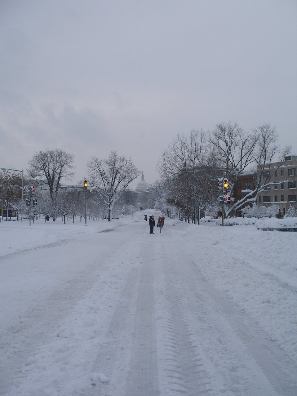 People out enjoying the Capitol Hill area of DC on a vehicle-deserted street following the February 5-6 snowstorm.  Pennysylvania Avenue, one of the busiest automobile thoroughfares in DC.