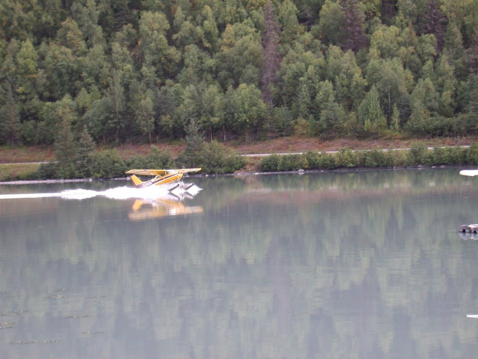 Float plane landing in glacier melt lake.