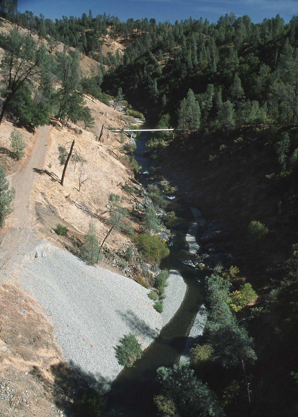 Far view of gravel injection site below bridge.