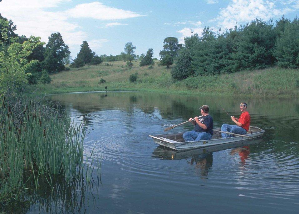 A well-designed farm pond with surrounding wildlife habitat offers excellent recreation in rural Van Buren County, Iowa.