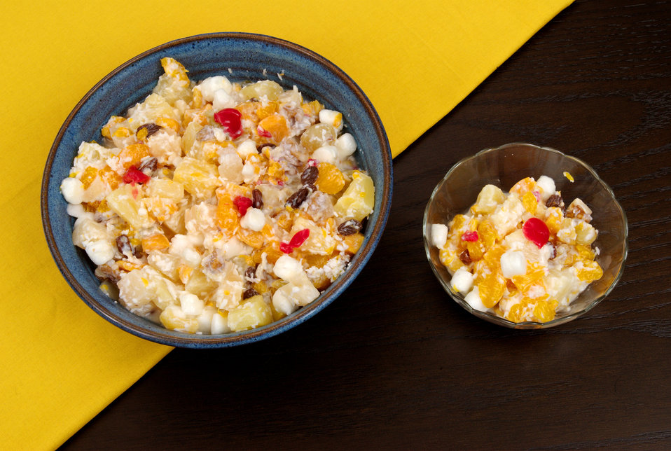 This is a Polynesian spin on a traditional dessert. Known as Hawaiian Ambrosia, this fruit salad contains the usual mandarin oranges, coconu