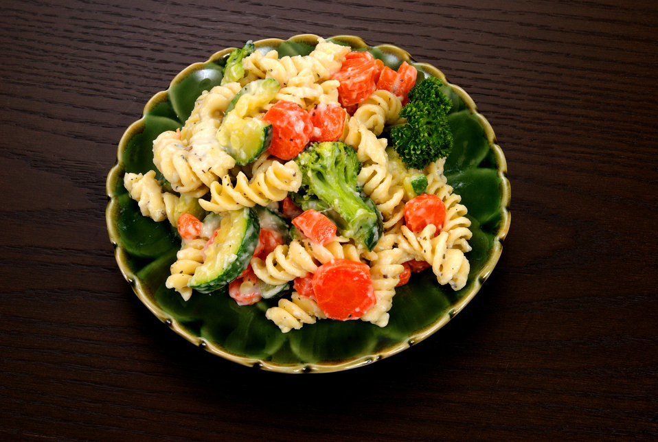 This image depicts a close view of a serving of Pasta Primavera, which had been taken from a larger plate of the salad, depicted in PHIL 130