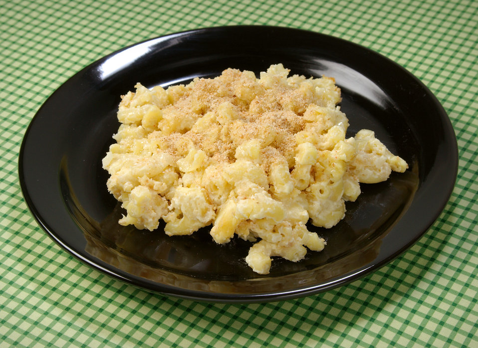 This image depicts a plate of macaroni and cheese. The original recipe uses whole milk, butter, and full-fat cheese, a recipe that contains