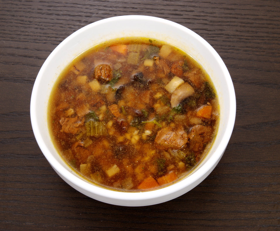 This photograph depicts a bowl of Beef Barley and Lima Bean Soup.  As nutritious as it is delicious, the ingredients for this dish includes