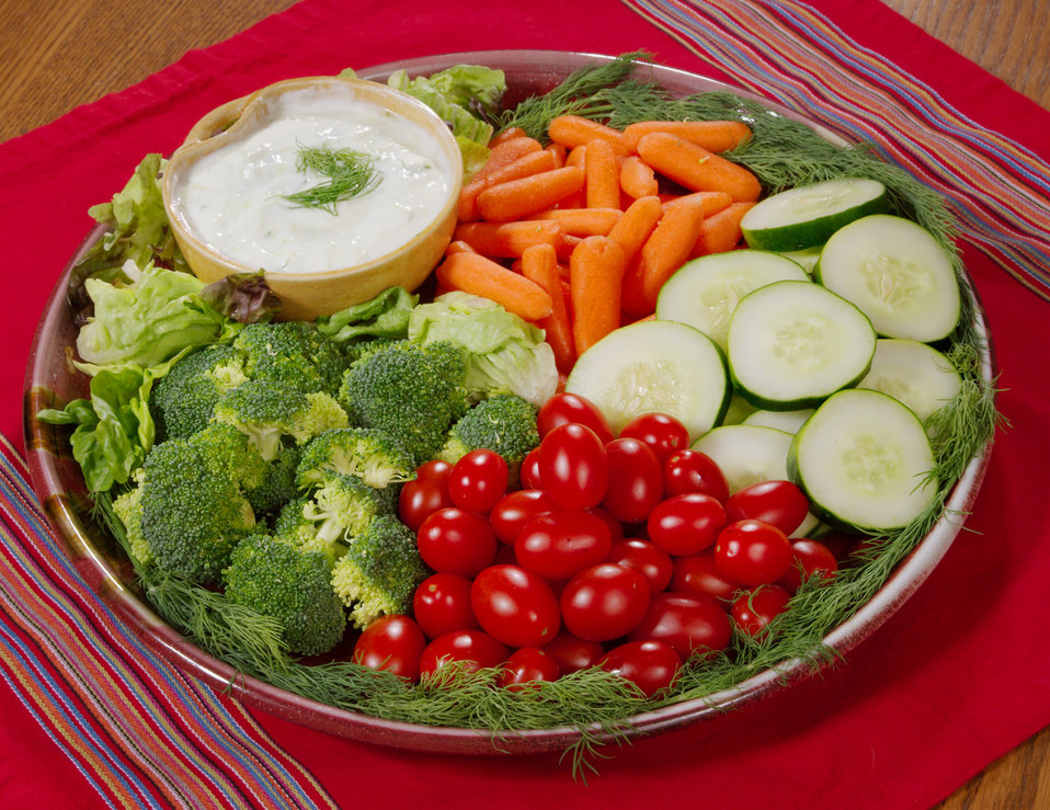 Here we have a platter of fresh vegetable, and a low-fat dip. The plated veggies included bright-red sweet grape tomatoes, uncooked broccoli