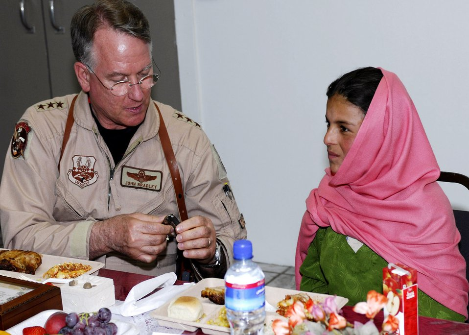 AFRC commander presents goods to Afghan girl, village