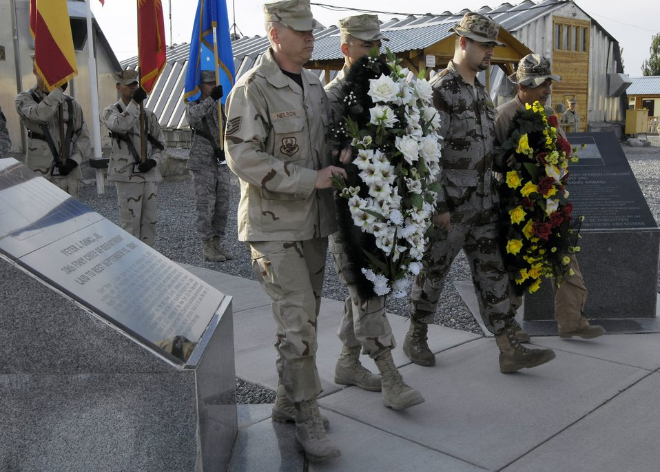 Manas AB Coalition team pauses to remember the fallen
