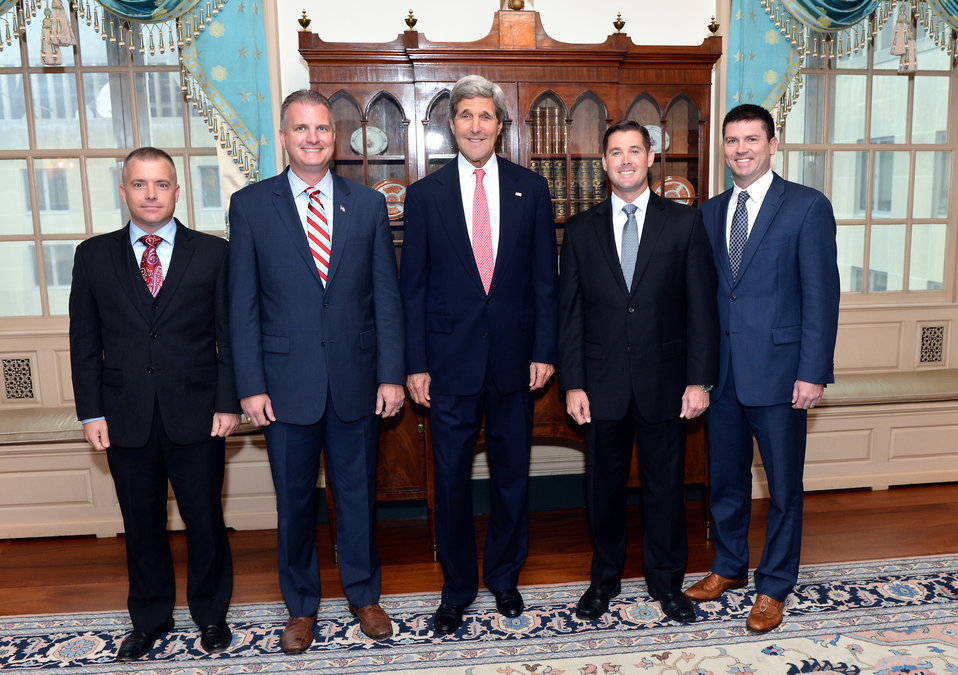 Secretary Kerry Poses for a Photo With Departing U.S. Air Force Fellows